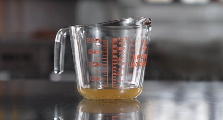 Measuring cup with a little grease