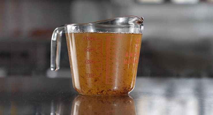 Measuring cup filled with grease